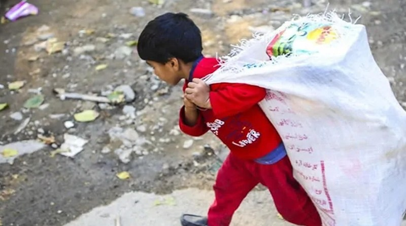 A young Iranian boy working in the streets. Photo Credit: Iran News Wire