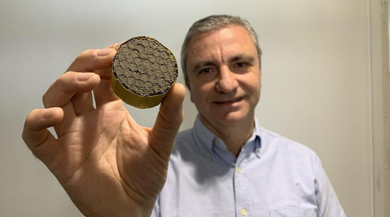 Professor Michele Meo with lightweight aerogel suspended in a honeycomb structure CREDIT University of Bath