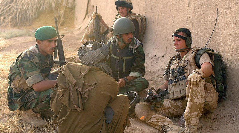 File photo of British soldier discussing the situation with a local resident via a translator and Afghan National Army soldier. Photo Credit: ISAF photo by Staff Sgt. Jeffrey Duran, U.S. Army, Wikipedia Commons