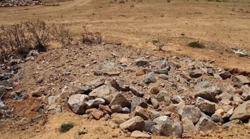 One of the numerous mass graves of civilian victims in Tigray, massacred by ENDF and allied forces. Photo Credit: VOA | Public domain.