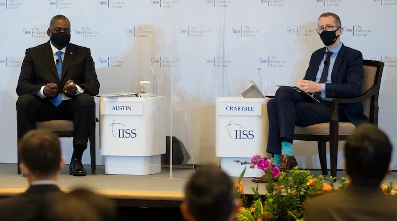 """Secretary of Defense Lloyd J. Austin III speaks with a moderator after giving remarks on """"The Imperative of Partnership"""" at the 40th International Institute for Strategic Studies (IISS) Fullerton Lecture in Singapore, July 27, 2021. Photo Credit: Chad J. McNeeley, DOD"""