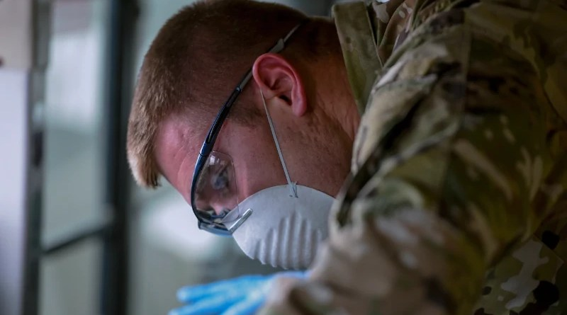 Air Force Staff Sgt. Colton Webber, 735th Air Mobility Squadron passenger terminal shift supervisor, decontaminates a bus after transporting passengers at Joint Base Pearl Harbor-Hickam, Hawaii, March 25, 2020. Photo Credit: Air Force Tech. Sgt. Anthony Nelson Jr.