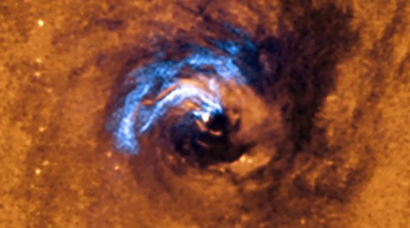 The image shows the process of nuclear feeding of a black hole in the galaxy NGC 1566, and how the dust filaments, which surround the active nucleus, are trapped and rotate in a spiral around the black hole until it swallows them. CREDIT: European Southern Observatory (ESO).