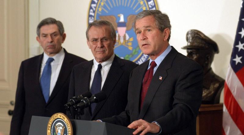 US President George W. Bush, Defense Secretary Rumsfeld, and Deputy Secretary Wolfowitz in March 2003. DoD photo by R.D. Ward, Wikipedia Commons