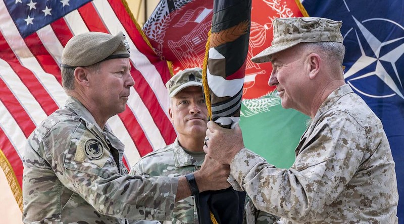 Army Gen. Austin S. Miller passes the flag of U.S. Forces Afghanistan to Marine Gen. Kenneth F. McKenzie during a ceremony in Kabul July 12, 2021. Photo Credit: DoD
