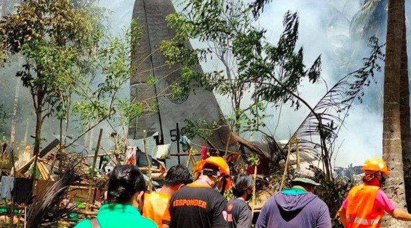 Rescuers search the site of a deadly C-130 plane crash in Patikul town, Sulu province, southern Philippines, July 4, 2021. Courtesy Joint Task Force Sulu