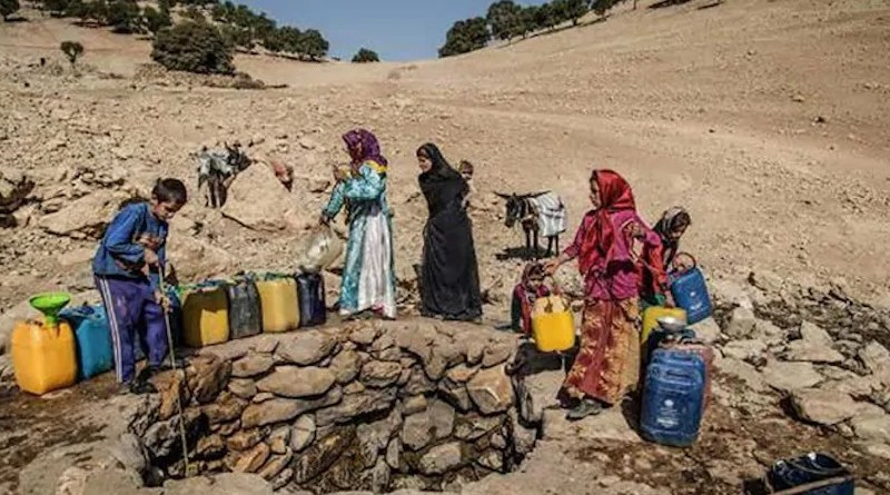 Iranians getting water from a well. Photo Credit: Iran News Wire