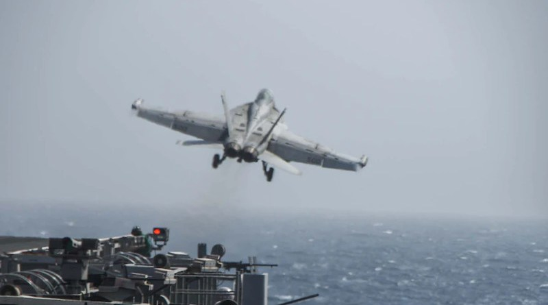 """An EA-18G Growler electronic attack aircraft, attached to the """"Shadowhawks"""" of Electronic Attack Squadron 141, launches from the flight deck of aircraft carrier USS Ronald Reagan during flight operations in the Arabian Sea, July 2, 2021. The Ronald Reagan Carrier Strike Group is deployed to the U.S. 5th Fleet area of operations in support of naval operations and providing airpower to protect U.S. and coalition forces as they conduct drawdown operations from Afghanistan. Photo Credit: Navy Seaman Oswald Felix Jr."""