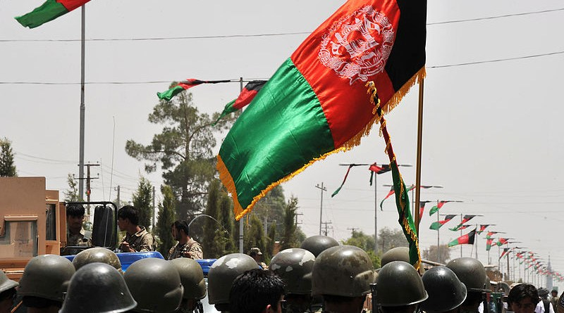 The flag of Afghanistan flies over the Afghan National Army. Photo Credit: POA Hamish Burke, Wikipedia Commons
