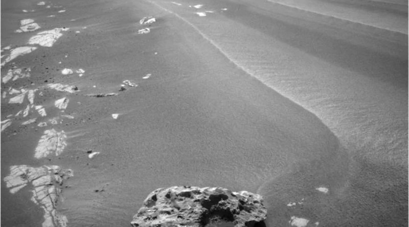 """Image of """"Block Island"""", an odd-shaped, dark rock on the surface of Mars, which is thought to be a meteorite. This object was imaged with the navigation camera on NASA's Mars Exploration Rover Opportunity on sol 1959 (July 28, 2009)."""
