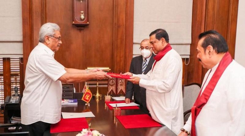 Basil Rajapaksa being sworn in as Sri Lanka's Minister of Finance by President Gotabaya Rajapaksa and in the presence of Prime Minister Mahinda Rajapaksa. Photo Credit: Office of Sri Lanka President