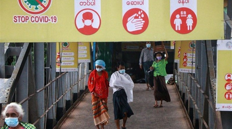 Signs in Myanmar warning people to protect themselves from coronavirus. Photo Credit: Tasnim News Agency