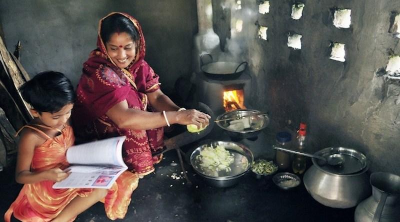 Ms. Shefali Ghosh from Savar, near Dhaka, teaches her daugher in the kitchen. Credit: The World Bank
