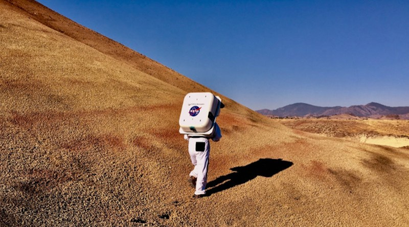 NASA Haughton-Mars Project field test of new technologies for human Moon and Mars science and exploration in Oregon. Shown here is the Collins Aerospace spacesuit for analog studies, equipped with integrated Information Technologies and Informatics Subsystem (IT IS), undergoing testing in the Moon and Mars-like landscape of the Painted Hills at John Day Fossil Beds National Monument. CREDIT (NASA Haughton-Mars Project / Sawan Dalal)