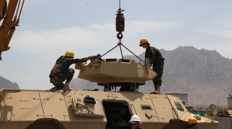 Afghan National Army (ANA) students remove the turret on a US-supplied ASV-150/M-1117 armoured vehicle as part of maintenance training, 2013. Photo: Wikimedia Commons/SGT Kent Redmond