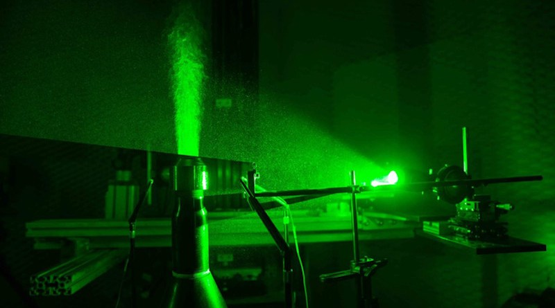 Lasers illuminate the plume of a scale-model F-18 Super Hornet jet engine in a University of Cincinnati aeroacoustics lab. UC engineers developed a new engine nozzle that muffles the noise from jet engines without hindering performance. CREDIT: Andrew Higley/UC Creative