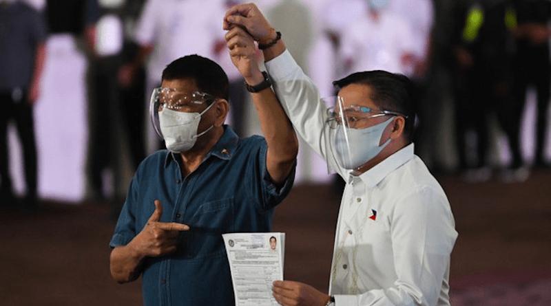 "Philippine President Rodrigo Duterte (left) accompanies Sen. Christopher ""Bong"" Go as the lawmaker files his certificate of candidacy to enter the vice-presidential race, in Manila, Oct. 2, 2021. Photo Credit: FOCAP Pool/BenarNews"