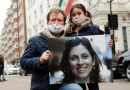 Richard Ratcliffe holds a a picture of his wife, Nazanin Zaghari Ratcliffe, as he and their daughter attend a protest outside the Iranian Embassy in London. (File photo, Social Media)