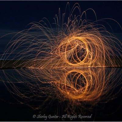Fireworks reflections by Shirley Gunter