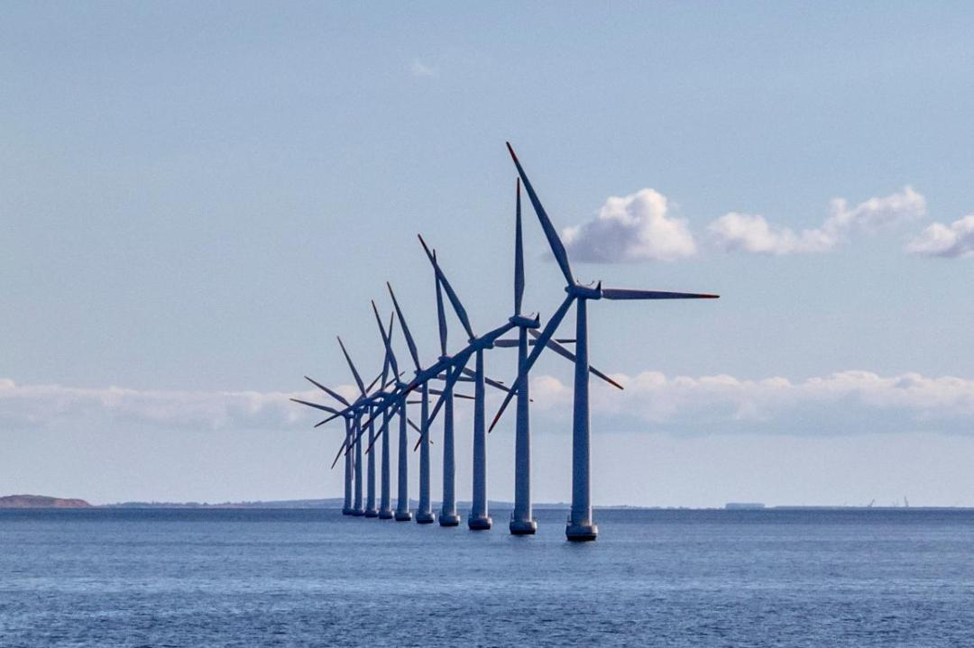A line of offshore windmills in Denmark