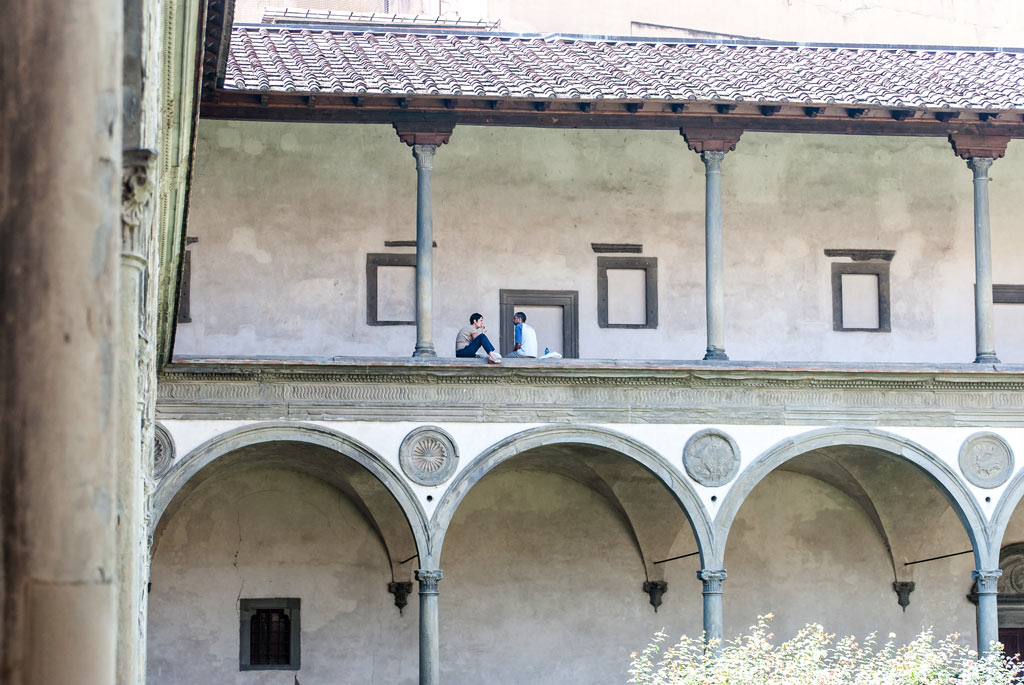 Two people eating lunch in the Interior Courtyard