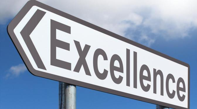 "Direction street sign with ""Excellence"" on it"