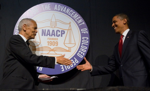 US President Barack Obama shakes hands with NAACP chairman Julian Bond (L) during the NAACP 100th Anniversary convention in New York, July 16, 2009. AFP PHOTO / Saul LOEB (Photo credit should read SAUL LOEB/AFP/Getty Images)