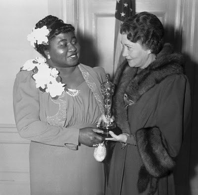 Hattie McDaniel (shown receiving her Academy Award from Fay Bainter)