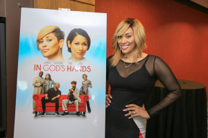 Keke Wyatt poses with movie poster
