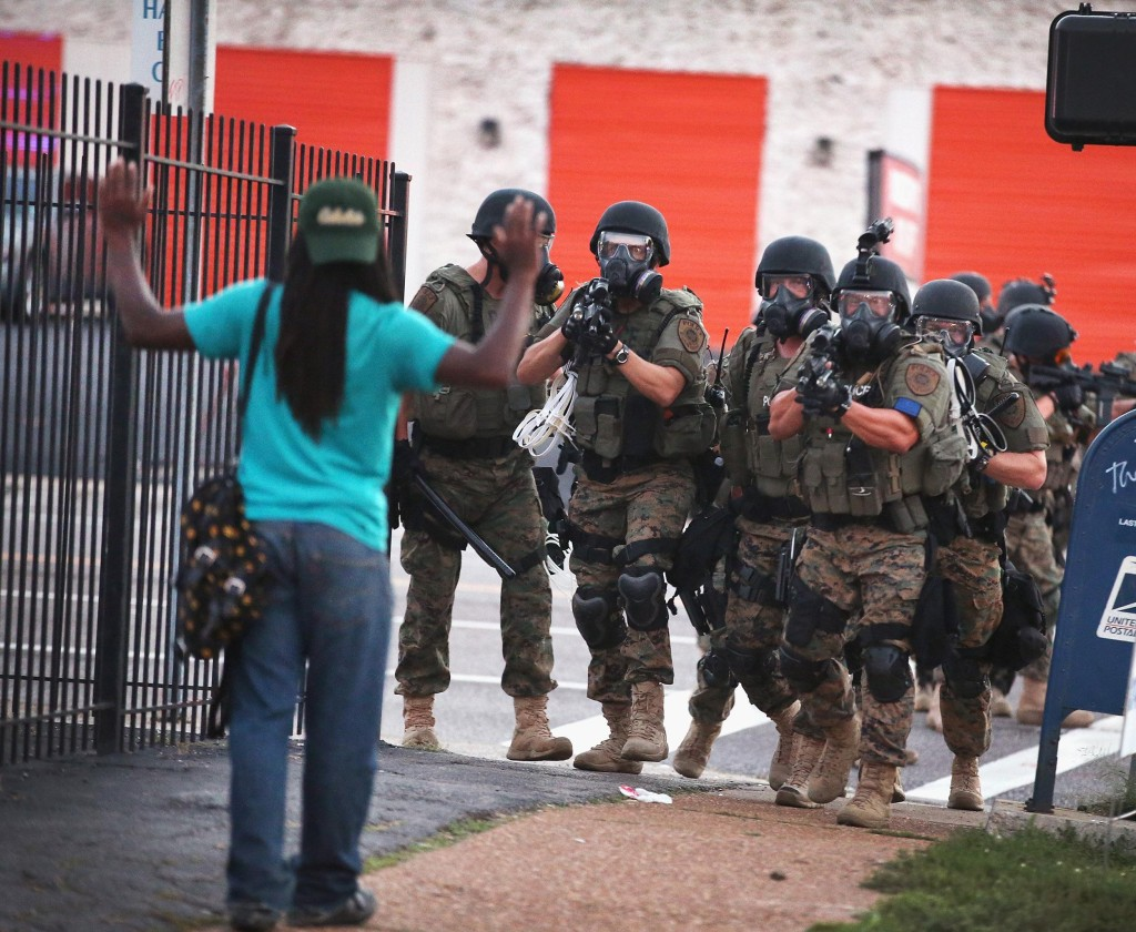 Police force protesters from the business district into nearby neighborhoods on August 11, 2014 in Ferguson, Missouri.