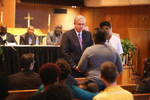 Missouri Governor Jay Nixon speaks about the unrest in the town of Ferguson following the shooting death of Michael Brown to residents and faith and community leaders during a forum held at Christ the King UCC Church on August 14, 2014 in Florissant, Missouri.