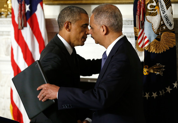 President Barack Obama (L) embraces Attorney General Eric Holder (R) at a ceremony where Holder announced his resignation at the White House September 25, 2014 in Washington, DC.