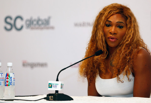 Serena Williams of USA talks to the media during previews for the WTA Finals at the ArtScience Museum on October 19, 2014 in Singapore