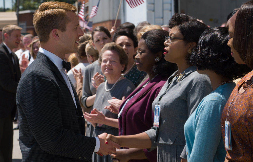 Katherine G. Johnson (Taraji P. Henson), flanked by fellow mathematicians Dorothy Vaughan (Octavia Spencer) and Mary Jackson (Janelle Monáe) meet the man they helped send into orbit, John Glenn (Glen Powell). (Hopper Stone Photo)