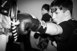 a photo of a student training in one of our adults boxing Tameside classes at Evade Martial Arts