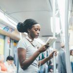 Girl reading on subway