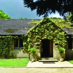 Lady's Wood Cotswold stone lodge covered in ivy