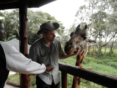 Events and Adventures Members Feeding Girafes in Kenya