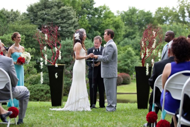 outdoor ceremony altar with coral branch urns and orchids