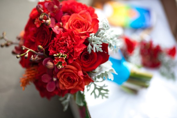 red bridesmaid bouquet roses carnations kalanchoe blossom red mokara orchids seeded eucalyptus dusty miller