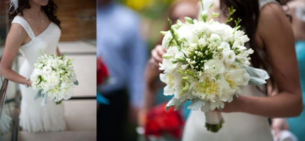 All white bride bouquet orchids roses dusty miller