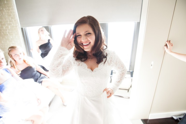 Happy bride in front of a window