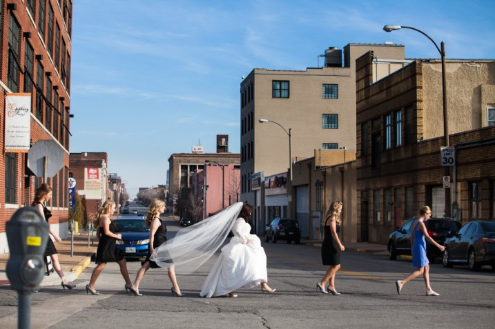 Bride and bridesmaids crossing the street like Abbey Road