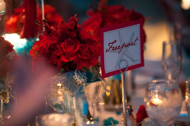 Custom island table names numbers with red flowers
