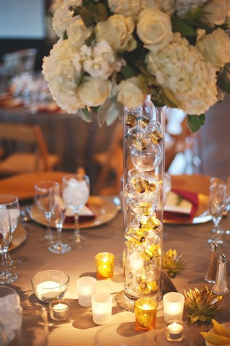 Clear vase filled with lightbulbs centerpiece