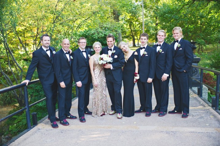 Black and gold wedding party in a park