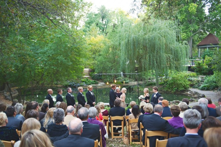 Wedding ceremony in a park willow tree
