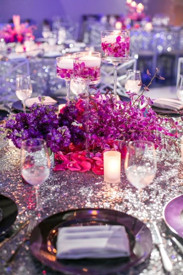 Purple flower centerpiece silver sequin tablecloth linen candles sparkle orchids