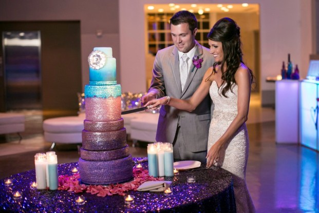 Bride and groom cutting sequin wedding cake purple turquoise
