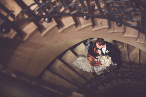 Bride & Groom in spiral staircase | Events Luxe Weddings